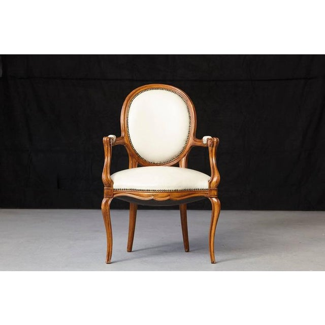 Gorgeous Louis XV style fauteuil with a molded walnut frame, having an oval back and shaped seat covered in nail trimmed...