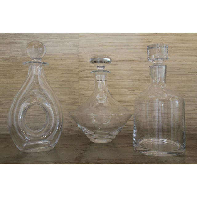 These are three mouth-blown liquor/ wine decanters, These are all very heavy with large flat glass stoppers. These...