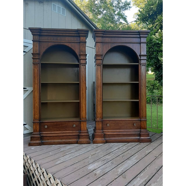 Item offered is a pair of very rare and very handsome Drexel Et Cetera French style Aged Walnut Bookcases/Open Display...