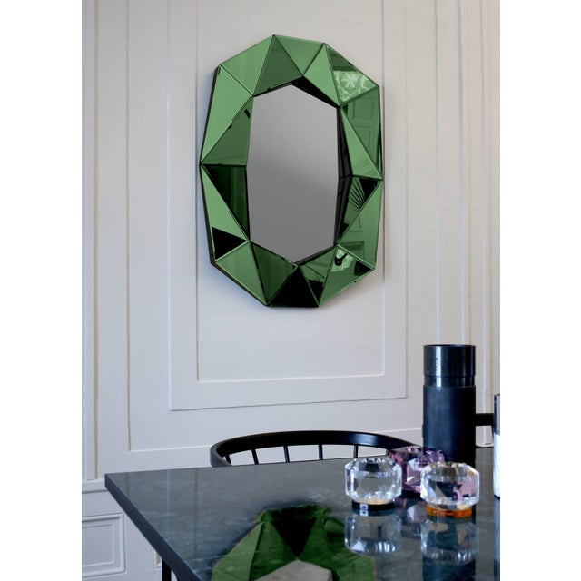 Diamond decorative mirror Mirror 4mm faceted mirror on black painted mdf Measures: L 72 x H 100 x D 6.2cm The luxury...