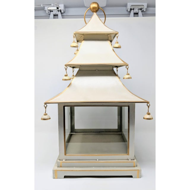 This handcrafted vintage three-tier tole pagoda lantern features a creamy white color base accented with gilded edges. The...