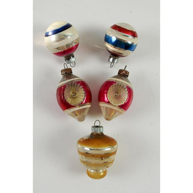 Group of 5 various colors, shapes vintage Christmas ornaments. Size varies, some fading, color loss, discoloration to...