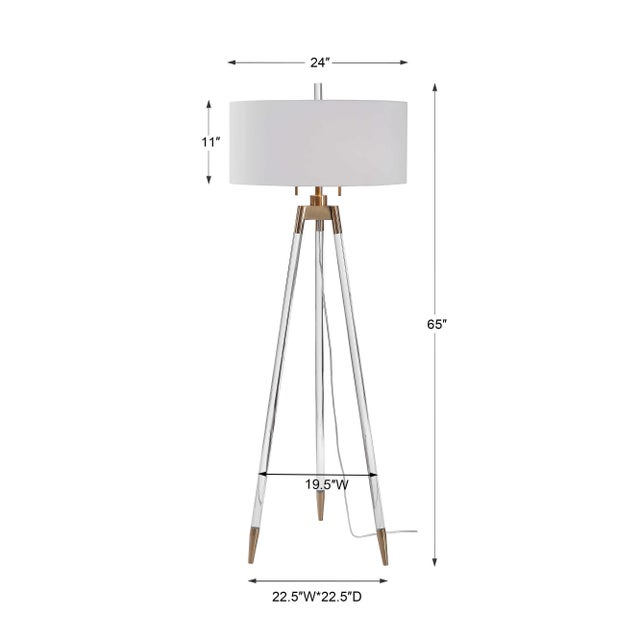 I love this elegant take on tripod style lighting! This floor lamp design features clear acrylic legs with brushed brass...