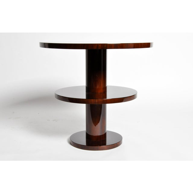 This gorgeous newly made Art Deco style round table is from Hungary and made from walnut veneer.
