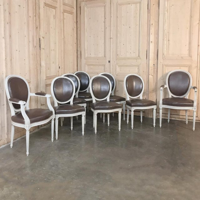 Set of 8 Antique French Louis XVI Dining Chairs includes 2 Armchairs feature a patinaed white painted finish and faux...