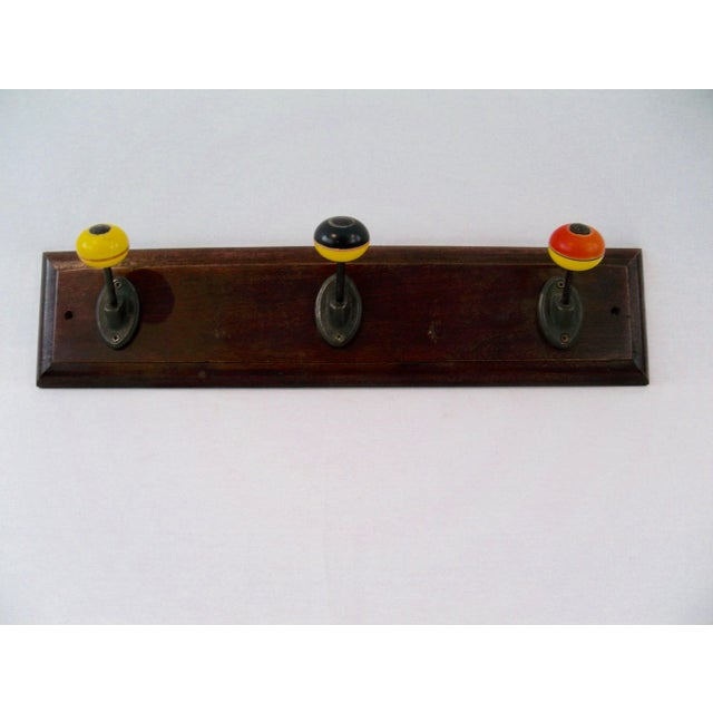 Beautiful oak board with 4 colorful bakelite adorned hooks. These are so colorful and pretty they would be a terrific...