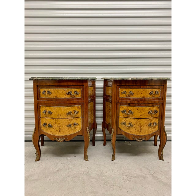 Gorgeous two tone birdseye maple and mahogany French night stands or side tables. Beautiful, natural green marble tops and...