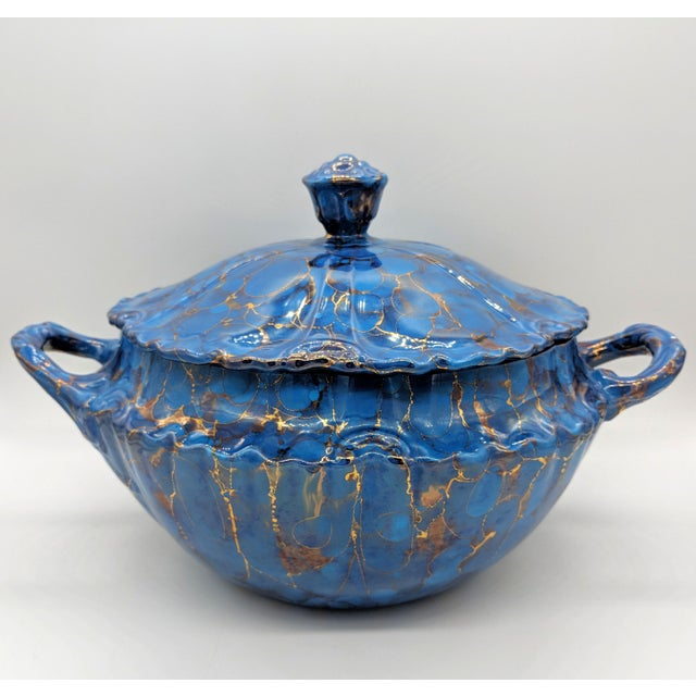 Gorgeous blue and gold swirl pattern on this large and elegant tureen. This would look incredible in a dining room or...