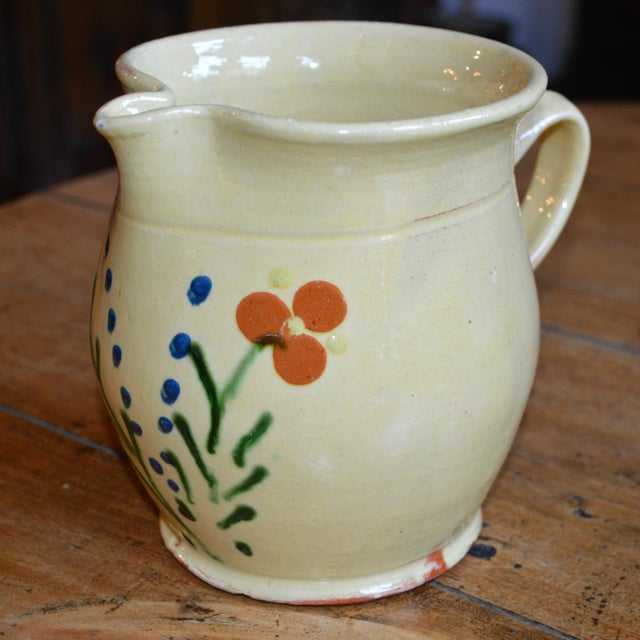 French handpainted terracotta floral pitcher from the South of France. Lovely breakfast nook centerpiece in one's French...