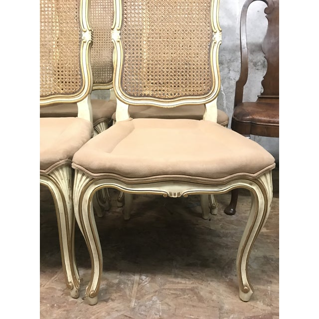 Pink upholstered rattan back set of four Louis XV French colonial chairs. Upholstery in great condition on made to look...