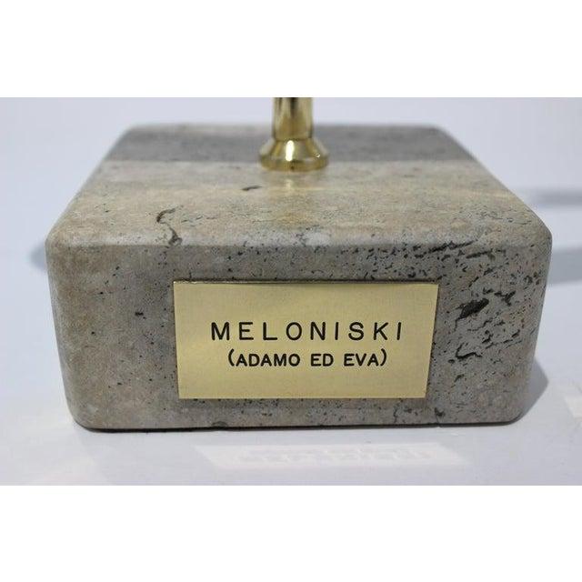 Melonski da Villacidro, Italy (1943-). Modernist bronze sculpture 'Adamo ed Eva' features the apple. The brass name plate...