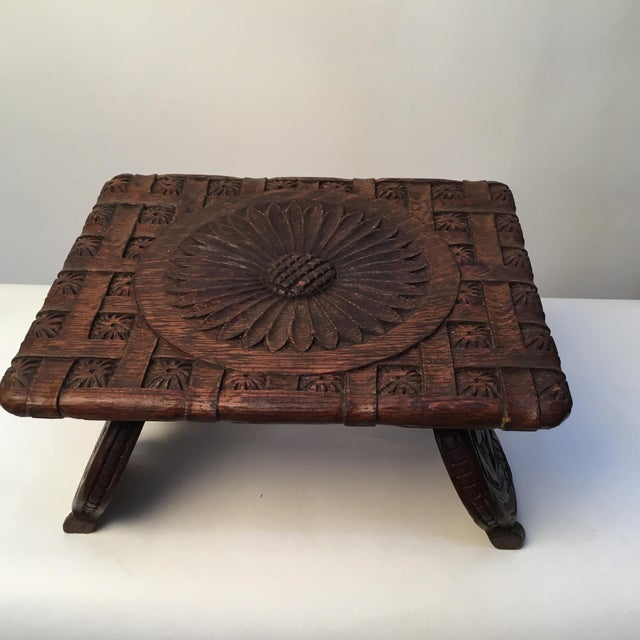 Charming little antique oak footstool. Basketweave pattern carving with large daisy flower centre. Scroll carvings on...