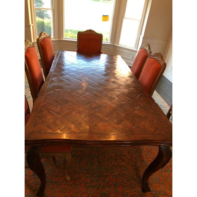 Beautiful French parquet dining table with self-contained extendable ends seats up to 10 comfortably when table is fully...