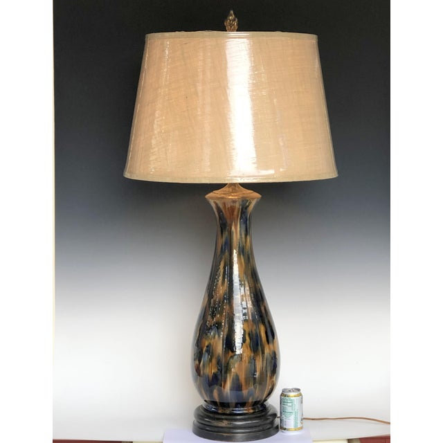 Huge, antique, hand turned, pottery table lamp in gloss blue brown mottled drip glaze, circa late 19th century. Attributed...