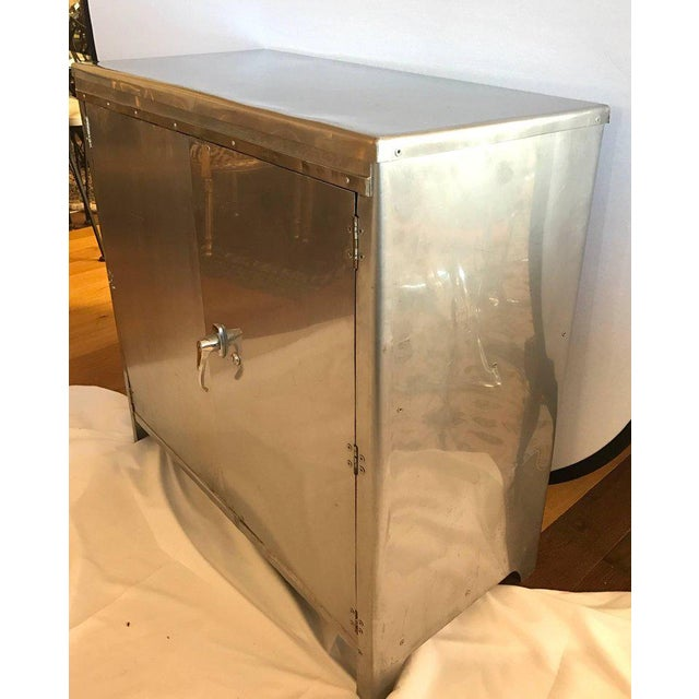 Multi purpose Industrial metal/steel bar cabinet or credenza with a polished finish. Has one shelf. Just the right size...