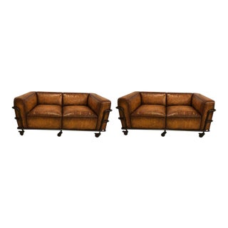 Pair of Industrial Style Sofas on Metal Frame Piping with Casters For Sale