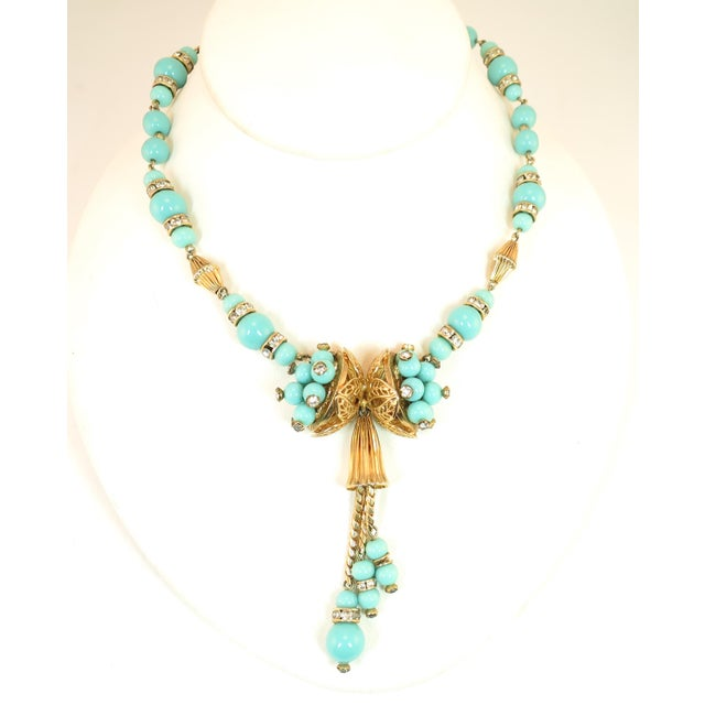 Offered here is a Miriam Haskell turquoise glass gold-plated necklace and bracelet set, made in Germany in the 1950s. The...