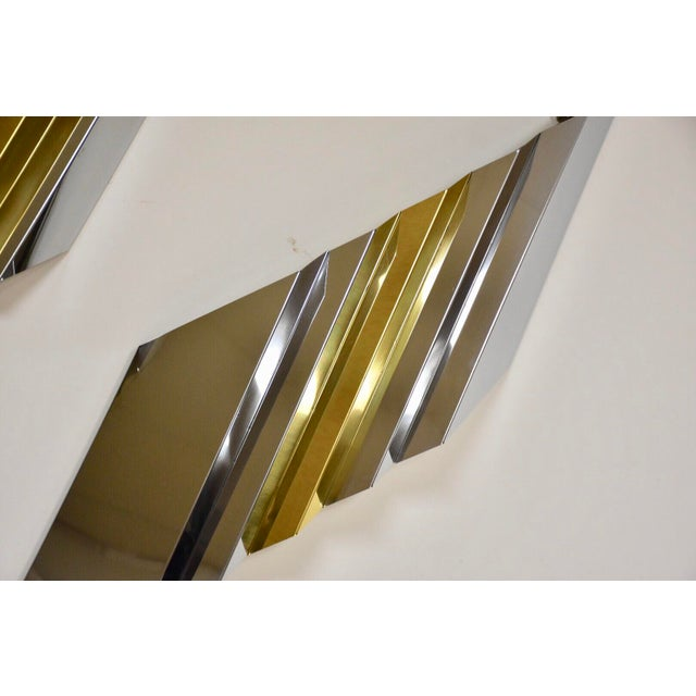 "A beautiful set of three mid century modern wall hanging louvered chrome and brass art. Large piece: 48.5"" wide. 11"" tall...."