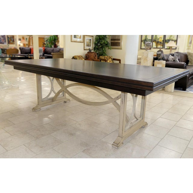 Habersham Tribeca dining table. Classical styled dining table with a urban edge to it, featuring a dark wood top finished...