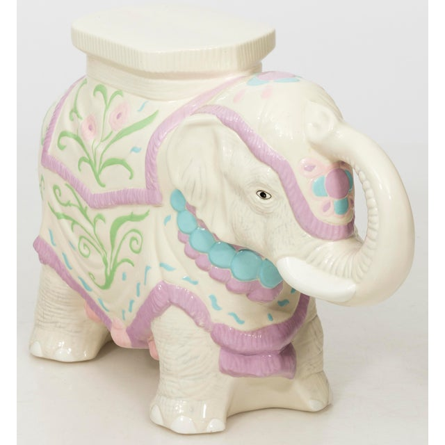 1960s Hollywood Regency style pastel colored ceramic elephant garden stool or side table.