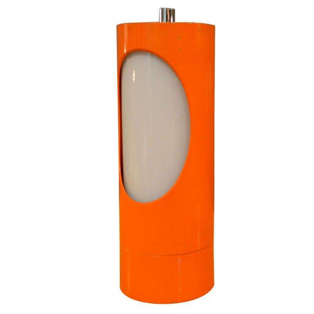 For your consideration a table lamp by Reggiani. The body is made of aluminum with original orange color. The body was an...