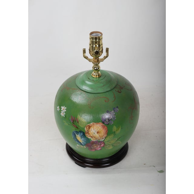 This hand-painted floral desk lamp depicts a set of flowers and leaves in bright colors. This is a perfect choice for...