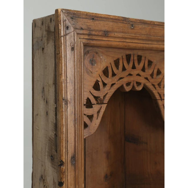 Wonderful antique pine hanging cabinet, with beautiful hand-carved pierced fretwork. Difficult to say what country it...