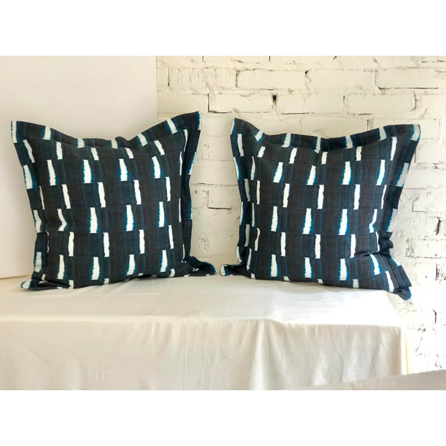 """Pair of 24"""" square flange edge linen pillows dyed indigo blue on white in a geometric stripe. The pillows have a hidden..."""