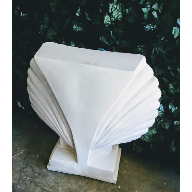 Stunning monumental Seashell form plaster console table with glass top. This seashell was done in a pure white high gloss...