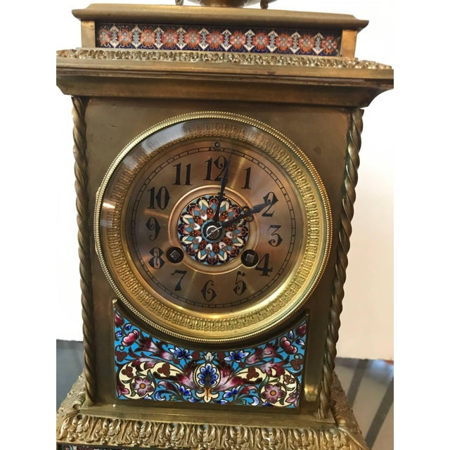 This is an antique Champlevé bronze clock from 19th century France. The piece is marked Richard et Cie, Rue de Bandy,...