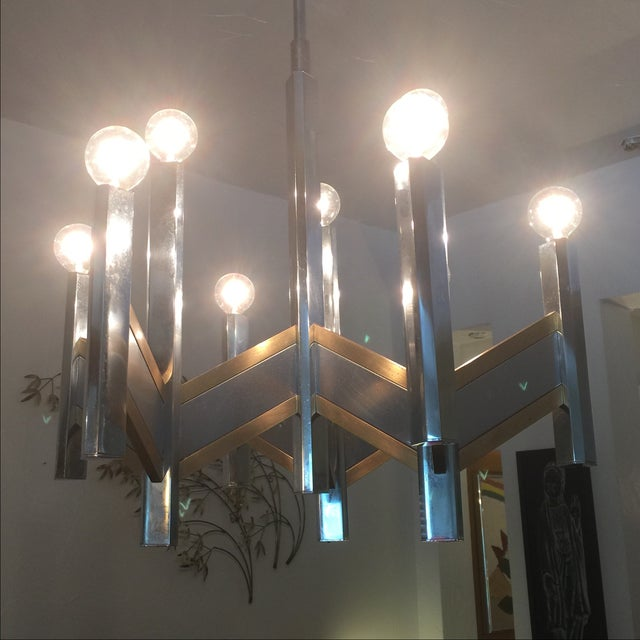 """9-light mid century chrome and brass chandelier by Sciolari. Drop off from celling is 45.5""""; could be adjusted with..."""