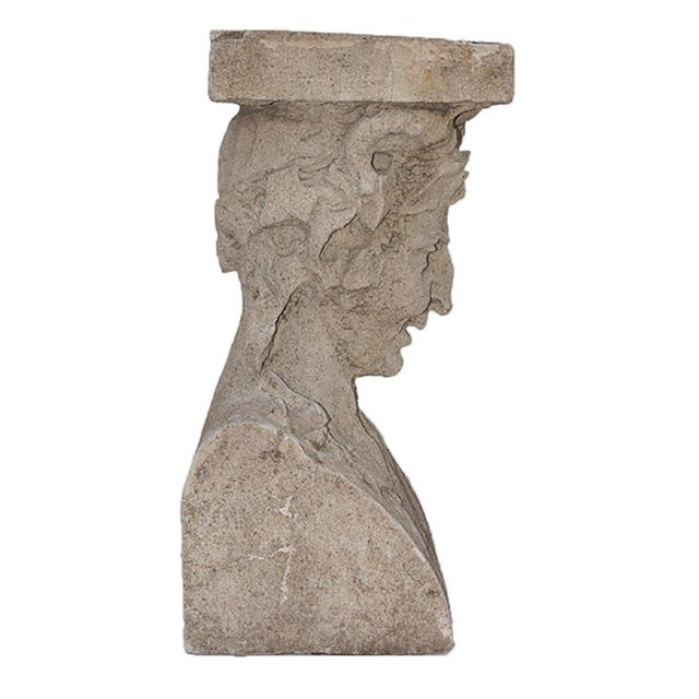 Pair of cast stone pedestals. Figural bust and foliate design. Late 19th century.