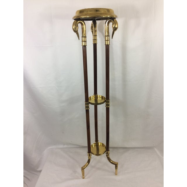 This quirky plant stand have swans' heads and fantastic brass feet. Dates to the 1890's. In good condition, with...