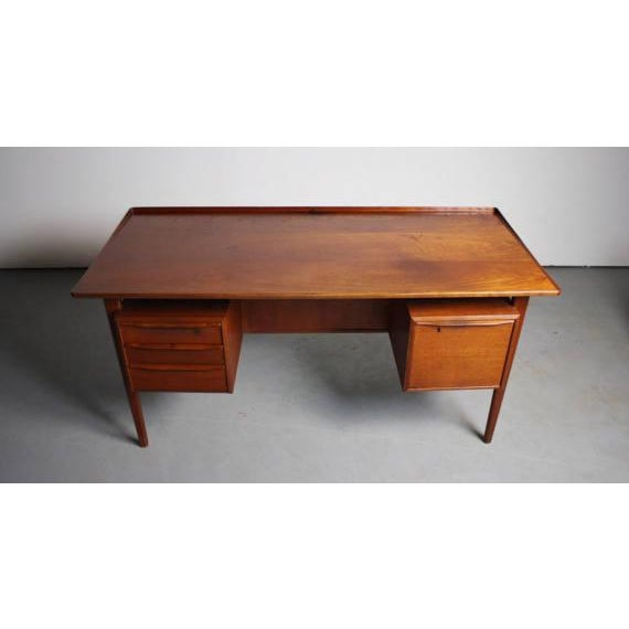 About this Rare Danish Teak Floating Top Desk by Peter Lovig Nielsen This desk is something to stare at. I sure know we...