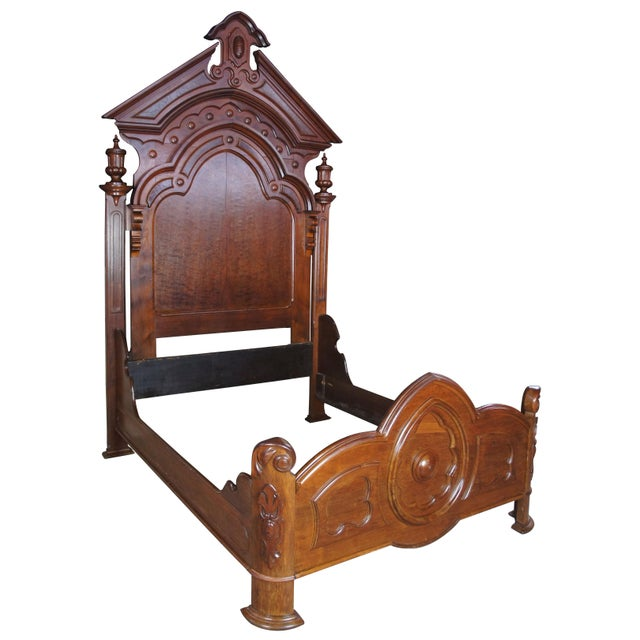 Mid 19th century Victorian Eastlake walnut carved Lincoln style bed. Features a high back with burled panels, carved...
