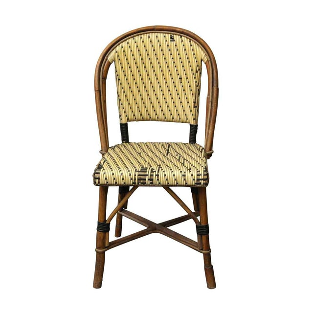 Yellow tone wicker chair with a medium tone wooden frame. Some chairs have wear and damages from age and use. Priced each.