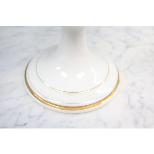 Fine white compote with punched holes and gold accents.