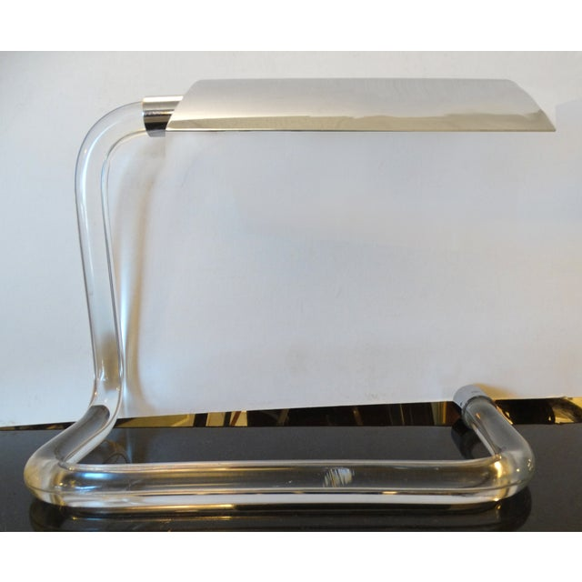 Crylicord Lucite desk lamp by Peter Hamburger for Knoll International. The Crylicord desk lamp consists of an adjustable...