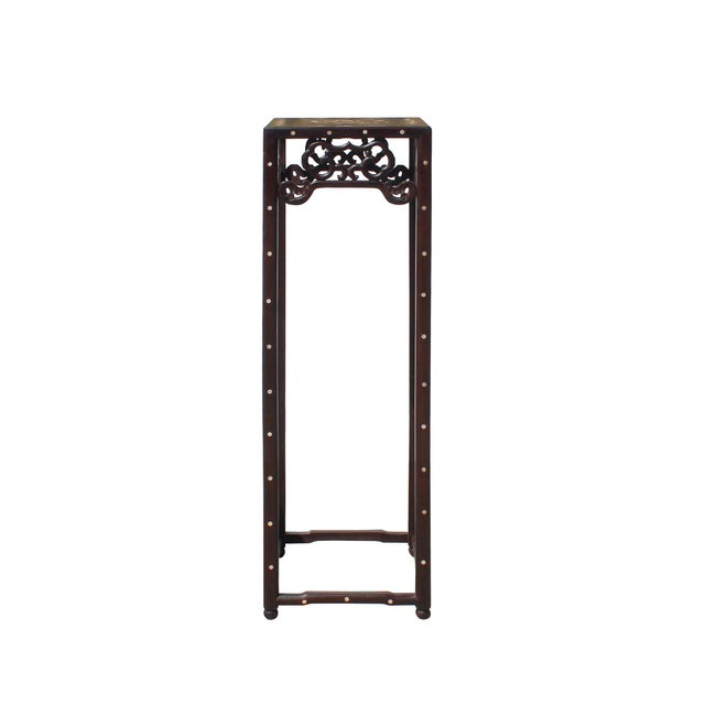 This is an oriental plant stand made of dark brown color Huali rosewood. It has an open section in the middle for extra...