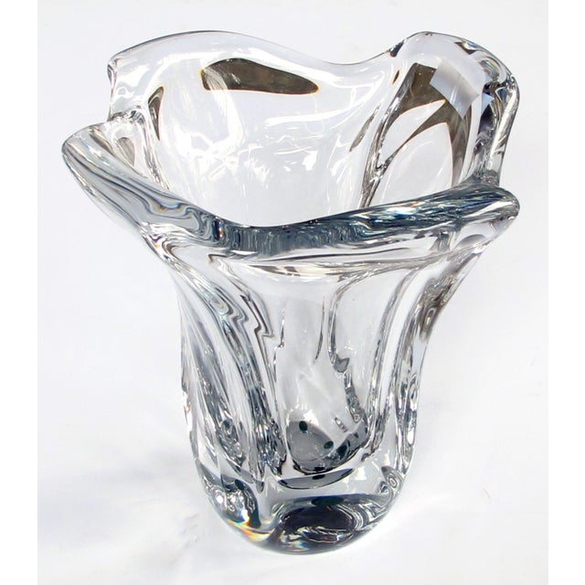 Of large scale, the shimmering crystal vase with lobed mouth tapering to the base; with acid etched signature 'Daum...