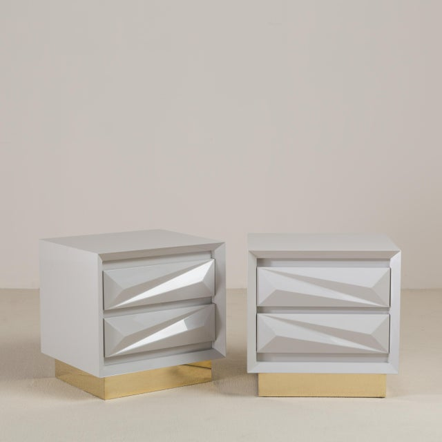 A standard pair of putty lacquered asymmetrical side cabinets on brass bases by Talisman Bespoke. This side cabinet is...