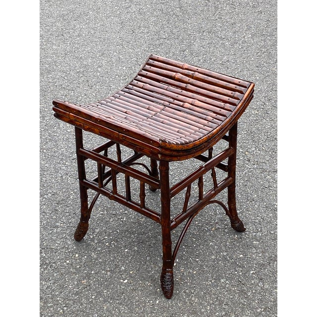 Beautiful antique bamboo bench or stool from England having a warm faux tortoise finish and lovely curved seat. Note: A...