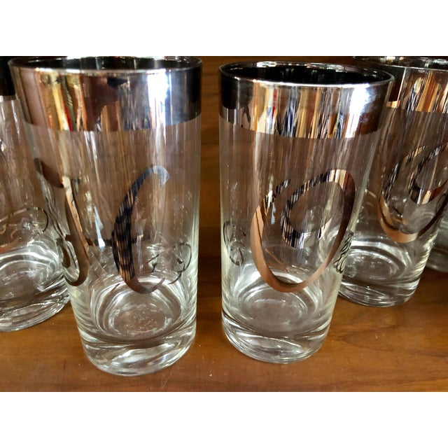 Vintage Dorothe Torphe style silver rimmed monogrammed HO HO HO glasses. Great conversation piece for the holidays.