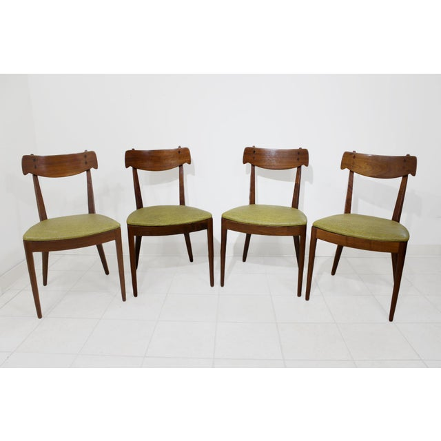 Made of walnut with rosewood inlays on the backrest, these elegant yet sturdily constructed chairs combine a Danish...
