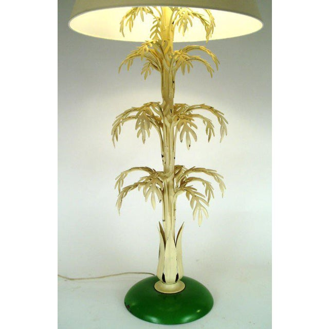 an unusual and charming tall painted steel palm lamp. beautiful form, with 4 tiers of leaves, and a round base. double...