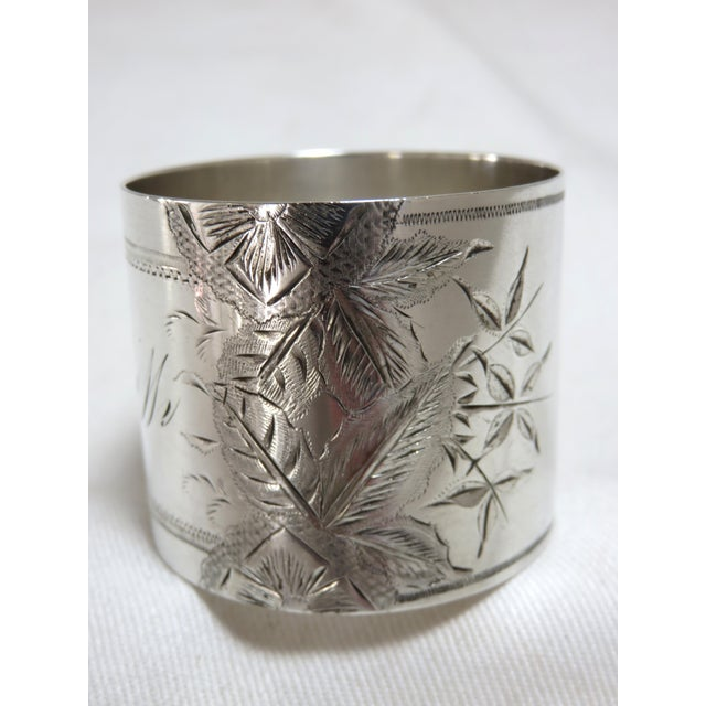 A very nice Antique American sterling silver napkin ring with hand Engraved Floral Decorations. Mid Victorian Era - Circa...