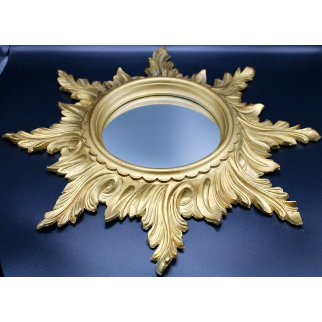 """A superb Mid-20th Century Gold Gilded Italian Sunburst Mirror with feather rays of alternating lengths. """"Italy"""" on..."""