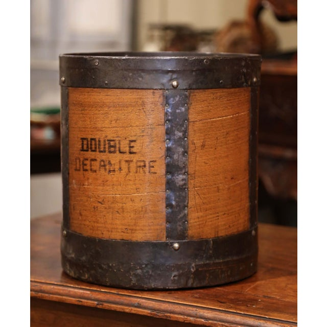 This antique grain measuring barrel was crafted in France, circa 1860. The basket features iron strapping motifs, forged...