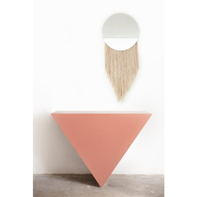 Made-to-order by Cuff Studio, Los Angeles. This stunning console appears to defy gravity by attaching to the wall by a...
