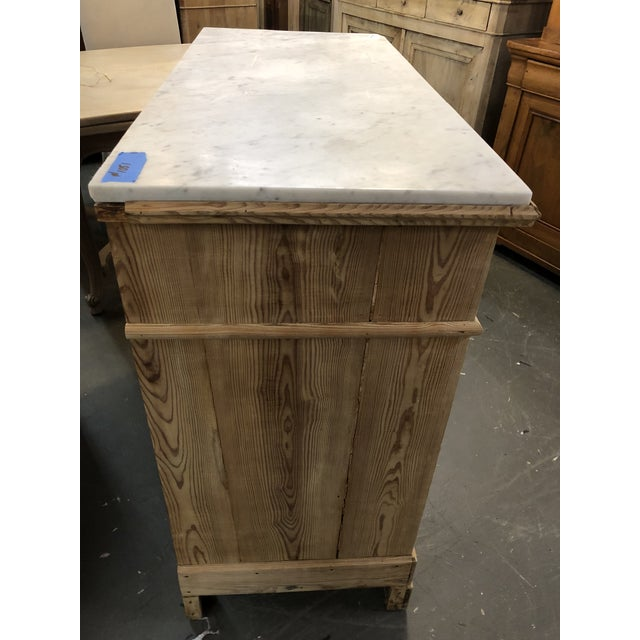 Gorgeous 19th C. stripped pine chest/ dresser/ drawer with a white marble top with grey veins. Four graduating drawers on...